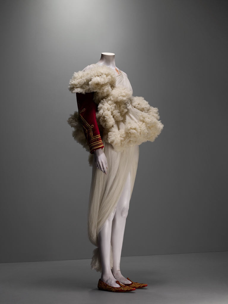 The Girl Who Lived in the Tree, autumn/winter 2008–9 Jacket of red silk velvet embroidered with gold bullion and trimmed with white shearling; dress of ivory silk tulle